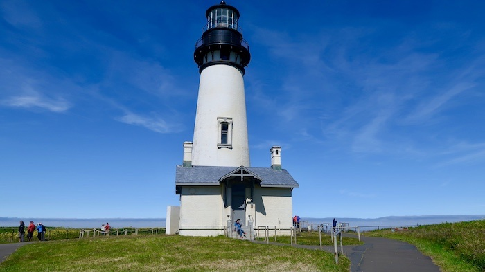 Reading at Yaquina Head Lighthouse, Newport, Oregon